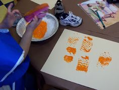 painting with shoes...might be fun to do with just flip flops during beach theme, or snow boots during winter theme