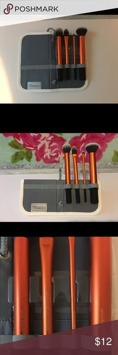 Real Techniques Makeup Brush Set New never used Real Techniques brushes.  Comes with contour brush, pointed foundation brush, detailer brush, buffing brush, and case that's still in plastic.  Case velcro's shut or folds into a standing holder.  No trades please, thanks for looking! Real Techniques Makeup Brushes & Tools