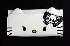 Hello Kitty - Skull & Crossbones Bow Clutch. $27.95 from NeatoShop. Click through to purchase.