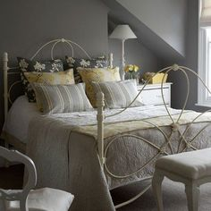 I like the grays and yellows, but I'd add some rose pattern somewhere, and white lacy curtains for the window.