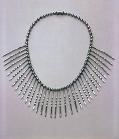The WW meant a shortage of materials.  But as this bobby pin necklace from 1946 proves, not a problem for the ingenious and witty  artist's imagination.