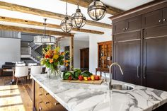 What a stunning rough-luxe residence! We love this design so much.   Traditional…