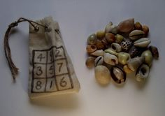 Hoodoo Magick Rootwork:  Cowrie Shells for divination.