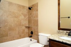 MOVE IN READY new home in Yukon, Oklahoma.  Valdera. Bathroom w/granite countertops. Custom cabinetry. Glenbrook floor plan.  10032 Volare Drive.  http://4cornershomes.com/c_movein_details.php?item=15&home=174