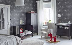 Black brown crib, wardrobe and diaper changing table in the corner of a large adult bedroom with grey patterned wallpaper. Childrens Furniture, Room Inspiration, Ikea Decor, Toddler Bedrooms, Furniture, Furniture Inspiration, Ikea Series, Ikea Interior, Room
