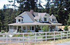 white farmhouse with wrap around porch *sigh*