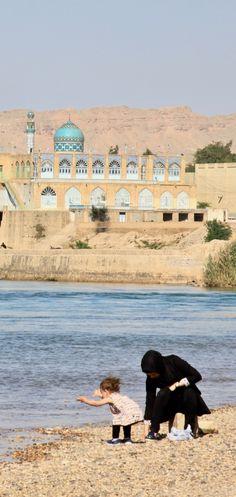 Mother and child on the edge of Band-e Mizan, Shushtar, Iran