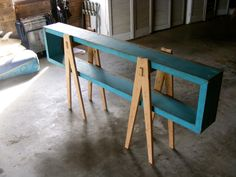 This project was created as a multi-purpose furniture item. It can be used as a side table, entertainment unit, bookcase and display shelf. This influence behind this piece was a reinterpretation of the 60's and 70's style sideboards that i admire. The seemingly heavy weight cabinet is supported usually my small thin legs and appears as if floating. I tried to re-create this in my piece by having the main blue unit suspended from the trestles and appearing to hang.