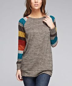 """Jardin by Macris Gray. Striped top. I bought this and absolutely LOVE it. It is a little longer than anticipated (I'm 5'4""""), but with the banded bottom you can slouch it if you want it up for a shorter look. Otherwise perfect with leggings or skinny jeans."""