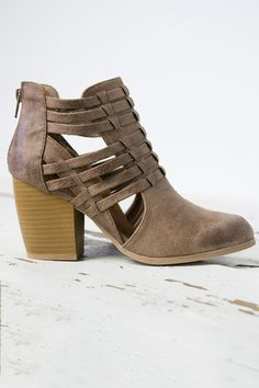 23d2aa13ef6 This shoe has a woven front with open sides and a zip up back for ease of  wear. The heel is cushioned and measures at the highest point.