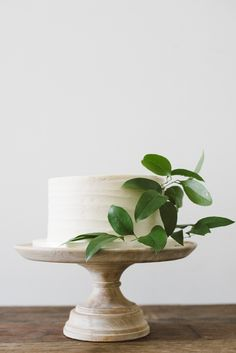 Simple white cake with greenery