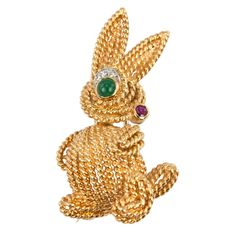 Van Cleef & Arpels Gold Bunny Brooch, Circa 1970s |An adorable bunny brooch by Van Cleef & Arpels in 18 karat yellow gold with a small faceted ruby for a nose and a green emerald cabochon for the eye and three small round single cut diamonds for the eyebrow. Circa 1970s. #CraigEvanSmall
