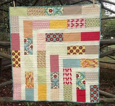 Pretty colors and interesting modern pattern and stitching.    Quilt 1 - Layer Cake Cot Quilt, via Flickr.
