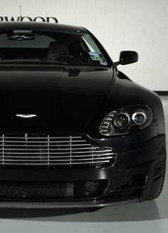 Cool black custom Aston Martin V8 Vantage! Click on the link to see the most badass wheels ever! #spon