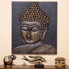 Art for wall space between windows over couch - LOVE THIS  Buddha Face Wall Hanging, Wood-Buddha Face Wall Hanging, Wood | World Market