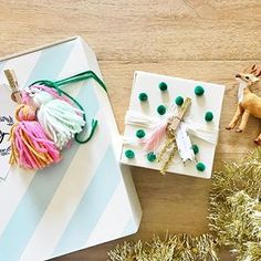 Gift wrapping in full swing over here... good thing I love it so much! Give me all the pom poms, yarn tassels, tinsel and tiny Christmas trees and I'm good to go! #holmesfamilychristmas #handmadechristmas #holidays #anthroholidays #anthropologie #anthro