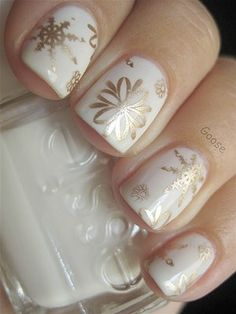 Snow White nails with gold flakes