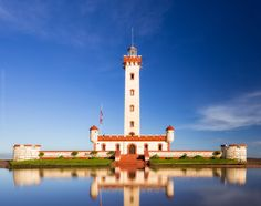 La Serena Lighthouse after rain, with the reflections formed by flooding...and yes, blue sky! something not quite popular here in 500px