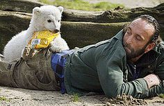 Knut stealing snacks out of Thomas pocket