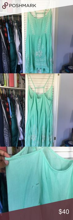 Free People Sip dress Worn once. Size small but feels like medium. Flowy and comfortable fit. Really pretty embroidery and color. There is a small hole in the back from it getting caught on an edge. Free People Dresses Midi