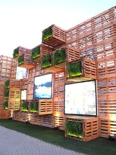 Pavilion Covered with 7,000 recycled wood pallets and several LED screen at Rio+20 Exhibition, Rio De Janerio, Brazil. Photo by Paula Alvarado.: