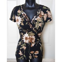 Floral Vneck Ruffle Blouse Relax Fit Small Casual Brand: Perseption Concept Size: S Color: Black and Multi-color floral pattern. Material: 92% Polyester, 8% Spandex.  Versatile blouse that can be worn casually or at work etc. Short cap sleeves with a ruffled V-neck. Shirt has stretchy and would easily fit a size up (medium). Macy's Tops Blouses
