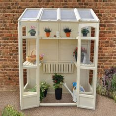 The Hartwood Victorian Tall Wall Greenhouse is flexible and compact. The Greenhouse includes two heights of shelving and the middle shelves can be adjusted to accommodate any taller plants. The greenhouse has two opening vents suitable for use with aut Diy Greenhouse Plans, Lean To Greenhouse, Greenhouse Gardening, Diy Small Greenhouse, Miniature Greenhouse, Greenhouse Wedding, Victorian Greenhouses, Wooden Greenhouses, Forest Garden