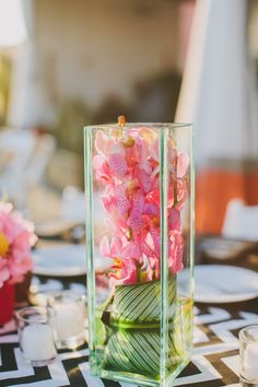 modern orchid centerpieces | Jackie Wonders Photographer | TheKnot.com