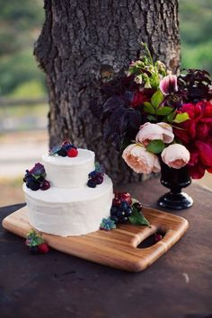 simple cake  + berries + arrangement - take out the reds and add some pewter and I love it!