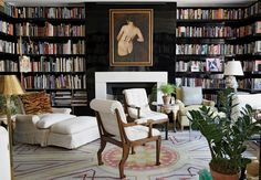 Always love black walls with white chairs! NYC: Daniel Romualdez's  black Lacquered library