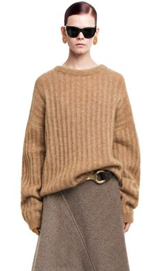 affd2b132c41 Acne Studios Dramatic mohair camel is a medium length, slightly oversized  boatneck sweater in a super warm mohair yarn.