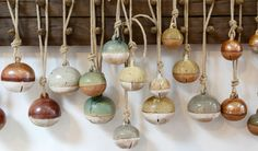 Ceramic bells (make like spirit rattle then cut openings when leather-hard)    Michele Quan