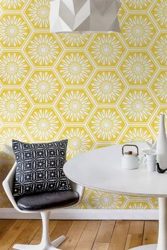 Wallpaper design featuring a repeated hexagonal tile effect pattern in the buttercup yellow colourway.