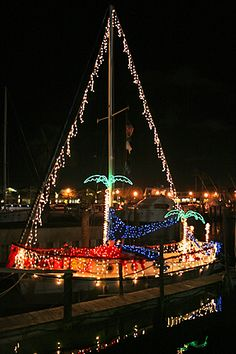 Holiday travel in Florida means dozens of events, like the Holiday Boat Parade in Dunedin, Florida where boats are decked in Christmas lights. State Of Florida, Florida Travel, Florida Beaches, Florida Keys, Tropical Christmas, Coastal Christmas, Beach Christmas, Christmas Deco, Holiday Lights