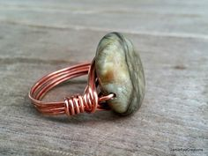 Green Jasper Statement Ring, Copper Wire Wrap Ring, Green Stone Copper Wrap Ring, Chunky Stone Boho Jewelry, Hippie Ring, Cocktail Ring by JamieRayCreations on Etsy https://www.etsy.com/listing/234041457/green-jasper-statement-ring-copper-wire #organicjewelry #handmadejewelry #cocktailring #bohemianjewelry #hippiefashion #bohoring