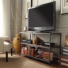 TRIBECCA HOME Harrison Industrial Rustic Pipe Frame TV Stand, Finish: Brown. Set includes: One (1) TV stand. Materials: PB wood, elm veneer and metal frame. Wood Finish: Brown. An open shelf on each table. Shelf clearance: 12 inches | Overall dimensions: 30 inches high x 18 inches deep x 50 inches wide.