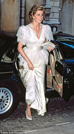 Bruce Oldfield made this romantic cream and satin Thirties- style dress for her, which she first wore here, at London's Somerset House, and then again the following year for a banquet at Buckingham Palace