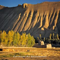 Sunset light creates deep shadows in the creases of the hillside in rural Bamian Valley, Afghanistan. ©Ric Ergenbright
