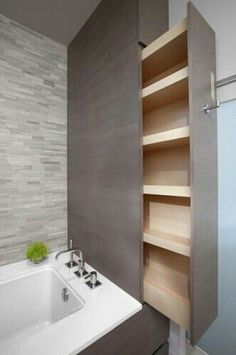 Sliding cabinet is a space saver in a long bathroom.