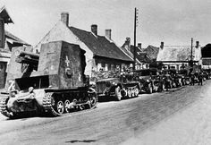 A number of vehicles escorted by two s.IG 33 'Bison' self propelled guns in the from and rear of the column.