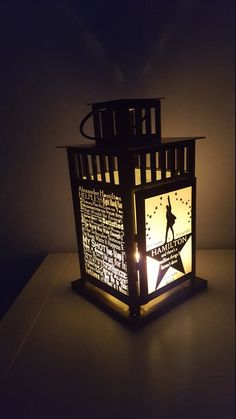 Hamilton Lantern from Storybook Craft Collective  https://storybookcraftco.com/collections/broadway-musical-collection/products/hamilton-broadway-musical-inspired-decorative-lantern