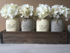 This listing is for our #1 seller color combination of the Neutral Toned Mason Jar Set! We are now offering this beautiful color set in a set of 4. This color set provides very soft grey and antique white tons. It is the perfect touch of neutral, but yet still gives a hint of color flare :) These are perfect for any rustic home decor or weddings! They also make the most perfect and unique gift that will be one of a kind! One thing that makes our centerpieces unique is that they are made…