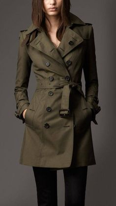 15 Stylish Trench Coats To Wear This Fall - a model is wearing a dark cold khaki trench coat with black pants