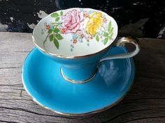Turquoise vintage Aynsley corset tea cup and saucer with a floral design inside the cup - made in the 1934-1950's by CupofTeaAntiques on Etsy