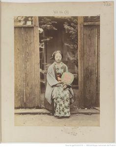 Woman holding an uchiwa fan. Meiji Period. Japan.
