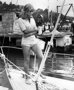 Julie Christie in Capri, 1965, on the set of Darling. Which she is in this tunic, shorts, tan and wind-swept hair look.