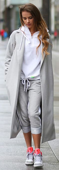 Athleisure Trend 2015: Julietta Kuczyńska is wearing grey tracksuit bottoms from StellaSport paired with Adidas sneakers and a maxi ash grey coat