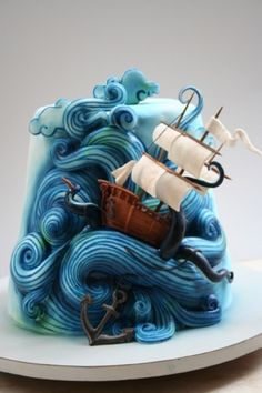 Amazing ocean blue and ship cake