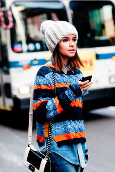 "bold colors and patterns make this slouchy knit sweater ""pop"" during bleak winter months"