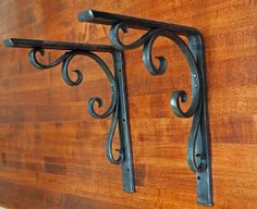 Sturdy scroll bracket hand forged by a blacksmith. $110.00, via Etsy.